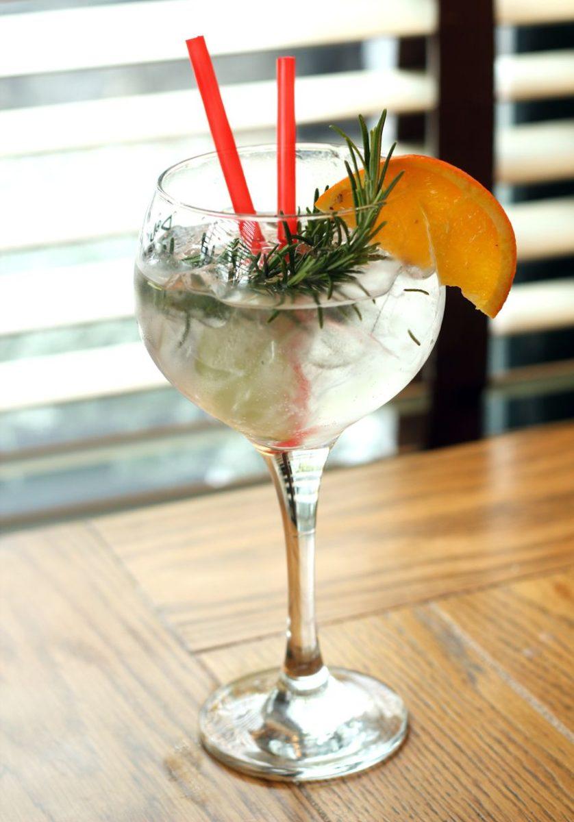 Bertha's Revenge Milk Gin with Fever tree elderflower tonic, rosemary, lime and orange garnish
