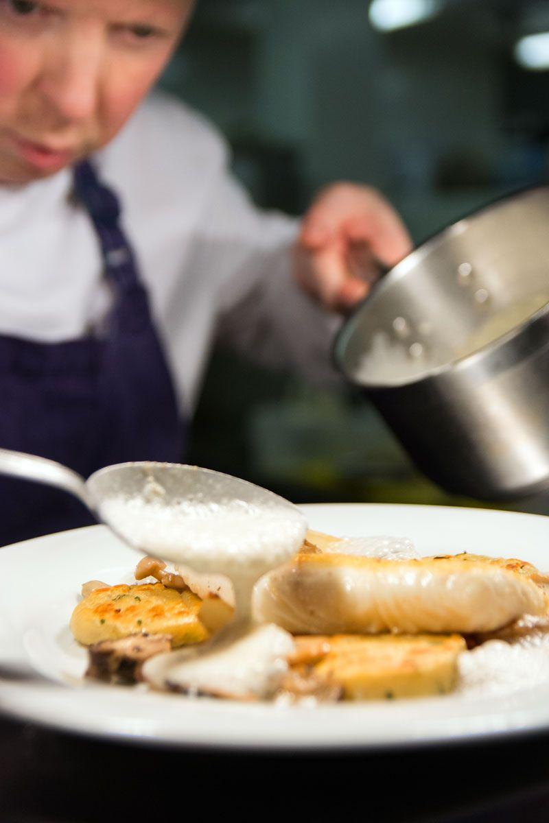Head Chef Kieran Murphy preparing a dish for Gallagher's Seafood Restaurant